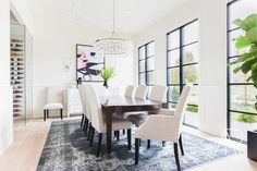 Traditional, glam pendant hangs above dining room table