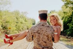 Cute photo of a soldier and his wife. red heels. being carried. military. camo.