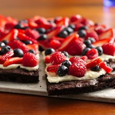 1 brownie mix; butter n eggs listed in mix; 8 oz cream cheese; ⅓ cup sugar; ½ tsp vanilla; 2 cup strawberries; 1 cup blueberries; 1 cup raspberries; ½ cup apple jelly