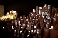 This is an installation made by the famous couple Kimchi and chips. The installation's name is 'Link'. It's an interactive installation where people can record their stories in a cityscape of cardboard boxes.