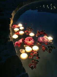 Floating flowers and candles in the fountain added a touch of beauty at night