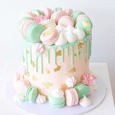 Macarons and meringue kisses on a cake by @deliciousbysara #macaronslady #frenchmacarons #pastelcollection #macaronstagram #meringues #prettycake #cake #southport #australia