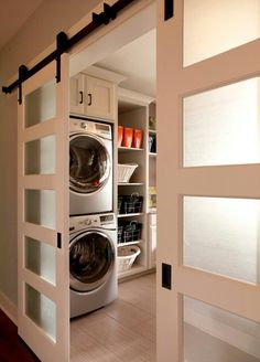 Small space laundry organization. Love these sliding doors as well.