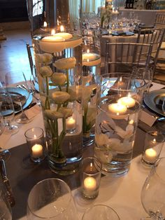 A simple elegant trio of submerged flowers are topped with floating candles to add ambiance to this Asian Art wedding.  #mccallssf #mccallscatering #mccallsfloral #asianartmuseum