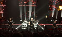 Nickelback performs at EnergySolutions Arena on Tuesday, June 12, 2012, in Salt Lake City, featuring Chad Kroeger on vocals and guitar, Ryan Peake on guitar and backing vocals, Mike Kroeger on bass and Daniel Adair on drums and backing vocals. (Leah Hogsten  |  The Salt Lake Tribune)
