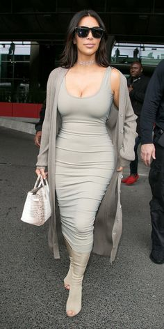 Wheretoget - Kim Kardashian wearing a grey bodycon midi dress, a grey long cardigan, grey open-toe knee-high boots, a white and brown snakeskin handbag, and black sunglasses
