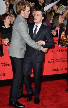 "Josh Hutcherson and Sam Claflin had an awkward embrace… | Celebs Hit The Red Carpet For ""Hunger Games: Catching Fire"""