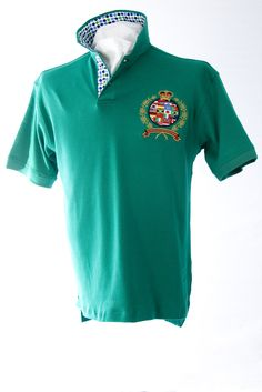 Our classic-fitting short-sleeved polo in breathable cotton interlock, finished with captivating Robert Owen Collection signature patch and embroidery.  Color: Green  Collar: (Blue, White, Navy Dots)  Two-button concealed twill placket,contrasting twill collar. Collar topside has fashionable print similarities of placket. Our embroidered International Crest accents the left chest. Accompanied by matching handkerchief. 100% cotton. Machine washable. Imported.  $70.00