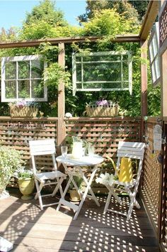 Love the idea of hanging window panes for an inside/outside look