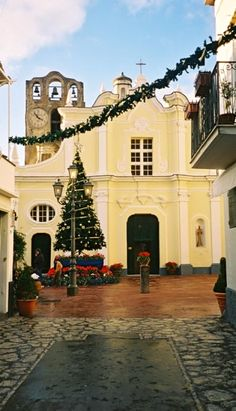 Natale in Italia (Christmas in Italy) This church is in Anacapri (the top of the island of Capri) and the kind of photo you can expect to see via my humorous travel anthology, Weird Little Travel Stories, many of which are based in Italy. Christmas In Italy, Christmas Time, Capri Italy, Naples Italy, Best Of Italy, Southern Italy, Visit Italy, Amalfi Coast, Italy Travel