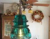 Repurposed Glass Insulator Pendant Light with Black Canopy and Cord. $149.00, via Etsy.