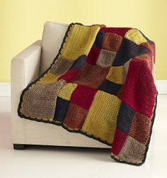 A colorful accent for any room, this throw blanket is crocheted in the warm tones of Vanna's Colors. The thickness of the yarn works up quickly and adds warmth to the finished project. (Lion Brand Yarn)