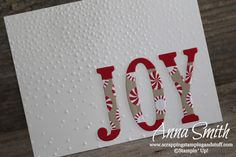 Clean and simple JOY Stampin' Up! Christmas card idea using the softly falling embossing folder and large letters framelits.
