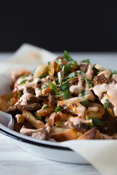 These totally loaded kimchi fries are the best appetizer ever! Super simple seasoned stir-fry beef mixed with sauteed kimchi topped over crispy cheese covered french fries. What's not to love?