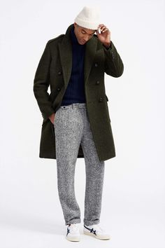Something as simple as opting for an olive overcoat and grey wool trousers can potentially set you apart from the crowd. To break out of the mold a little, make white leather low top sneakers your footwear choice.   Shop this look on Lookastic: https://lookastic.com/men/looks/overcoat-turtleneck-dress-pants/23228   — White Beanie  — Navy Knit Turtleneck  — Olive Overcoat  — Grey Wool Dress Pants  — Burgundy Socks  — White Leather Low Top Sneakers
