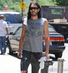 "Russel Brand loves his ""Chicks Ride for Free"",  Peanuts tee"
