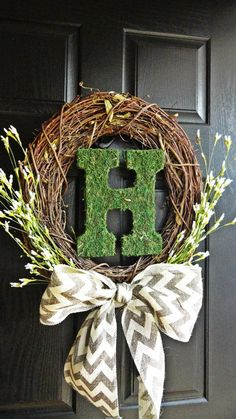 Bright White Wildflowers with Chevron Burlap Bow and Moss Covered Monogram Wreath. I could totally make this with the help of hobby lobby