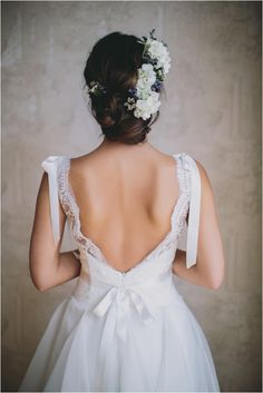 Alice Padrul Bridal Shoot by Codrean Photography   the flowers in her hair are perfect and I love the dress. such pretty lace.