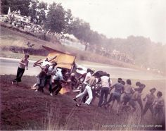 Embedded image permalink1972 Mclaren Can Am Crash @ Road Atlanta photo by Hal Corbin. Fans are helping Denny out of the car that is on fire