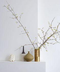 Gold Vase. Metal. Plants. Branches. Decor. Details. Mantle. Interior. Home.