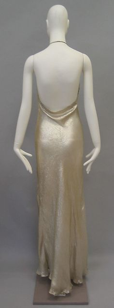 Evening dress  Madeleine Vionnet (French, Chilleurs-aux-Bois 1876–1975 Paris)   Date:ca. 1936Culture:FrenchMedium:silk, metalDimensions:Length at CF: 59 in. (149.9 cm)