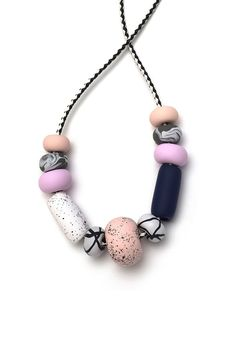 This necklace is part of the Northern Flicker range and features a variety of patterned and speckled hand-formed polymer clay beads in tones of blu...