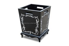Meet the classiest waste bin you've ever seen! Don't let a dull old plastic trash bin draw unwanted attention. Disguise your waste in style with the new Arabella baroque waste receptacle! Arabella adds style and personality into your room, allowing nothing in your room be boring. Fashionable and functional, the Arabella baroque waste bin is a stunning example to never settle for just average! Handmade from mahogany and finished in black lacquer with white accents.
