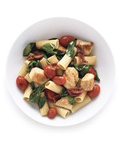 Pasta With Chicken and Bacon | After tucking into a bowl of our Pasta With Chicken and Bacon you'll likely be thinking about seconds—and wondering why you didn't come up with this on your own. It's so simple, incredibly quick to make, and it's loaded with ingredients that are hard for even picky eaters to hate (hey, they can push the tomatoes to the side if they must). The recipe requires only five ingredients: pasta, bacon, bo...