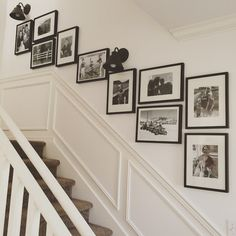 Unique Hanging Pictures Over Stairs