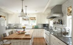 LOVE this kitchen-- love the scalloped hood (is it zinc? lovethelook), love the black and white, the butcher block island, thelights, the tile wall... LOVE