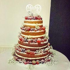Naked wedding cake, strawberries, raspberries, blueberries, Victoria sponge cakes, gypsophila.