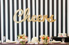 Black-and-White Striped Backdrop    Photography: EDLT Photo   Read More:  http://www.insideweddings.com/weddings/modern-spring-bridal-shower-with-a-pink-gold-black-color-palette/640/