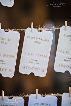 Concert ticket theme escort card at Herban Feast Sodo Park wedding for music loving couple