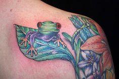 Beautiful frog sitting on a leaf tattoo design