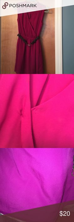 Express dark pink/ purple formal dress Such a great dress! Worn only a few times. The button connecting the top (shown in pic 2) has broken and I have it pined right now, probably a very easy fix. In pic 3 there are 2 small stains on the back of the dress that are hardly noticeable, they might even come out if it was cleaned. Priced for imperfections. Let me know if you have any questions Express Dresses Midi