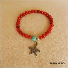 Coral rojo con estrella de mar
