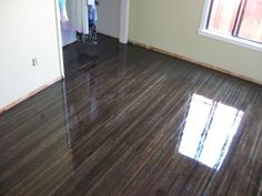 "5"" red oak stained black/ebony throughout first floor 