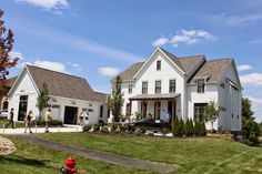 The Fat Hydrangea: Parade of Homes Week 2014 - House #3.   Look at that attached garage. Lights. Doors.