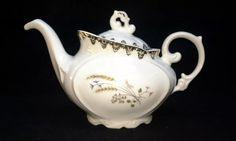 Starožitná konvička na čaj • zlacený porcelán