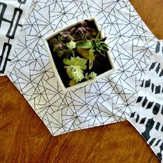 Hexagons are all the rage right now, so why not display them proudly with some bold coordinating fabric?  Easy and quick sewing project.