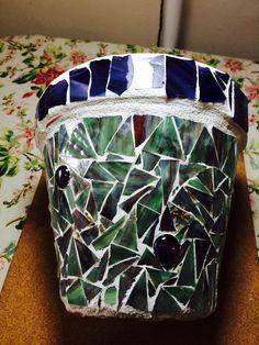 Green/purple mingled glass with purple/white mingled glass around top.