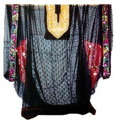 Typical outer Thob worn over a Dirha. (Pharyah)