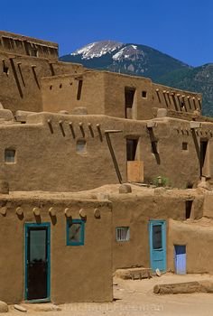 Taos Pueblo, National Historic Landmark, New Mexico - In the Pueblo Indian culture, painting doors and windows blue kept the evil from entering.