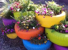 Painted Recycled Tires make a colorful flower box! A way to recycle and decorate at the same time. (I know ... the page is in spanish but get the idea!)