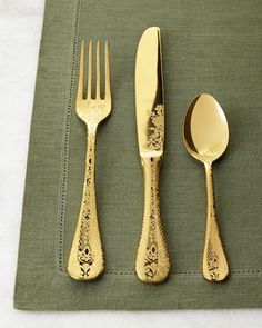 Flatware made of 18/10 stainless steel with a gold-tone titanium finish. Laser-etched design. Dishwasher safe. Place setting includes dinner fork, salad fork, dinner knife, teaspoon, and tablespoon. P