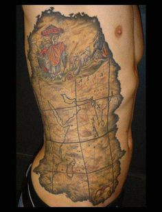 Map Tattoo done by Pat Delvar.