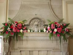 Two arrangements that could flank a large photo of you and M, or your initials. Cairnwood Wedding Mantle Flower Arrangements