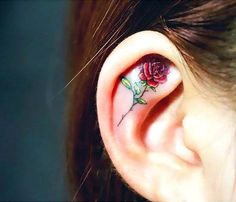 a-cute-and-elegant-tattoo-of-a-rose-inked-inside-the-ear