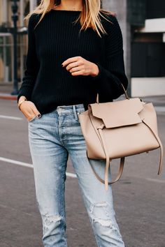 345fd746f8 Woman Wearing French Connection Black Chunky Sweater Mother Ripped Jeans  Celine Mini Belt Bag Taupe Fashion