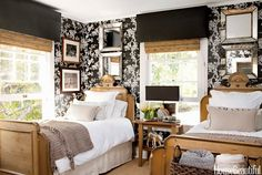 Antique French twin beds and Ralph Lauren Home's Marlowe Floral wallpaper give a period look to a guest room in Tobi Tobin's Hollywood Hills farmhouse.